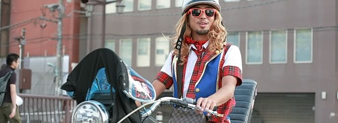 Japanese guy dressed in plaid skirt on motorcycle