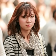 A wary look from a passing Japanese woman.