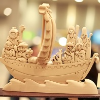 Wood carving of the Seven Lucky Gods and their Takarabune treasure ship.