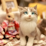 Stuffed cats with huge eyes and one wearing a kimono.