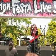 The Japanese cyberpunk industrial band Psydoll performs at the Design Festa live stage.⁽²⁾
