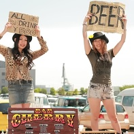 The beer chicks at the Bar Cherry next to the outdoor stage selling alcoholic refreshments.