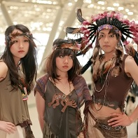Three Japanese performers dressed up as some weird kind of Indians.