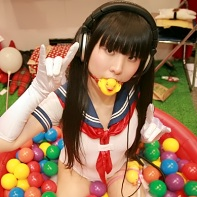 Japanese fetish model Moira Gabriel Coco with her naughty schoolgirl and rubber ducky shtik.⁽³⁾