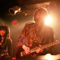 Ucchi of Psydoll playing guitars with Nekoi in the background.