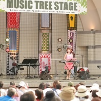 The singer Aeka performing on the Eco Life 2010 Music Tree Stage.²