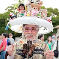 Old Japanese guy in elaborate cosplay with live goldfishes.