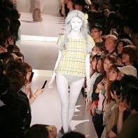 A model wearing a short-sleeve shirt from Yoshikazu Yamagata and a braided wig.