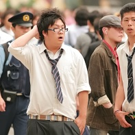 Two young Japanese guys with white shirts and loosely worn ties.