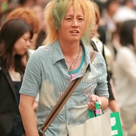 Stylish Shibuya boy with dyed hair and lightblue jeans shirt.