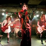 ManyCuRe with frontman Gou Tragedy at Club Crawl.