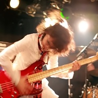 ManyCuRe's support bass player moshing while playing.