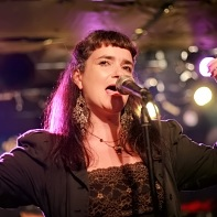 English-born singer/songwriter Lynne Hobday of Ray Trak singing.