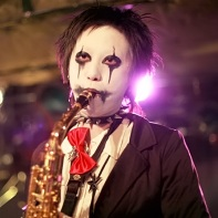 Ray Trak's saxophone player with black and white facepaint.