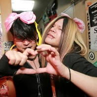 Two tough Japanese goth guys discovering their love for pink bows and hearts.