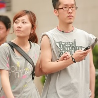 Another style-conscious Japanese couple in gray t-shirts.