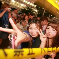 Despite the intervention of the police these two Japanese girls were still in a festive mood.