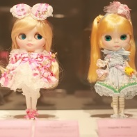 The Blythe dolls outfitted by the gothic lolita fashion labels Baby, the Stars Shine Bright (left) and Angelic Pretty (right).