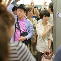 This train car was pretty much already full, so people queued up on the platform for the next train.