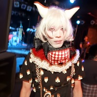 The Japanese goth guy Eren wearing a jester-like outfit with horns and white hair.