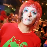"A Japanese guy with dyed hair and colorful facepaint including the kanji ""heroic self-sacrifice"" (玉砕)."