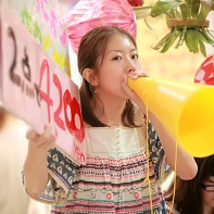 Like this girl, many of the salespeople used simple megaphones to advertise their stuff.