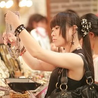 A fashionable female shopper examining some accessories.