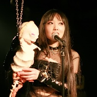 Schizkkha of Shingguapoura playing with a rubber doll with trailing entrails.