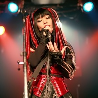 Psydoll's singer Nekoi wearing her signature cyberpunk fashion.