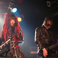 Nekoi and Ucchi of Psydoll on stage.