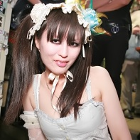 A Japanese girl in white gothic lolita fashion.