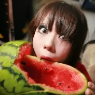 Tomoe eating a watermelon.
