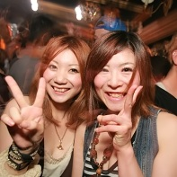 Two Japanese girls making v-signs.