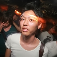 Japanese dude with a plain white t-shirt.