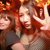 Two Japanese girls on the crowded dancefloor.