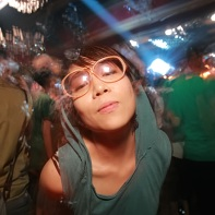 Japanese girl on the dancefloor wearing glasses.