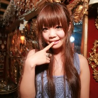 Long-haired Japanese girl in Shibuya's Trump Room club.
