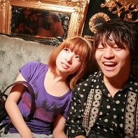 A friendly Japanese couple relaxing at the Kawaii Tokyo party.
