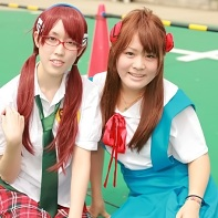Two female cosplayers dressed up as Mari Illustrious Makinami and Asuka Langley Soryu from the Neon Genesis Evangelion (新世紀エヴァンゲリオン) anime.