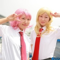 Two female cosplayer dressed up as Gabriel and Michael from the Saint Young Men (聖☆おにいさん) manga.