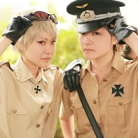 Two cosplayers dressed up as Prussia and Germany from the Hetalia: Axis Powers (ヘタリア Axis Powers) manga.