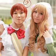 Two cosplayers dressed up as Italy and Hungary from the Hetalia: Axis Powers (ヘタリア Axis Powers) manga.