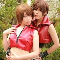 Two cosplayers dressed up as Meiko and Kaito from the Vocaloid computer program.