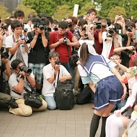 A typical scene at the Comiket 78: Dozens of photographers try to get a shot of a nice cosplayer.