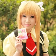 A girl cosplayer dressed up as Misuzu Kamio from the Air visual novel.