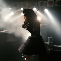 Rose Noire's female violin player Jill in backlight.