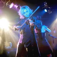 Singer Louie of the Japanese goth band Rose Noire is also a violin player.
