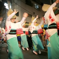 The women dance in their summer kimonos.