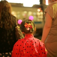 A young girl with her mother on her way home at the Shimokita crossing after the awa odori.