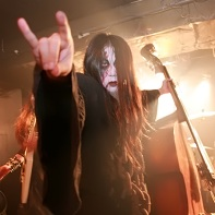 Vlad Demogorgon making the horns sign at the end of Ethereal Sin's performance.